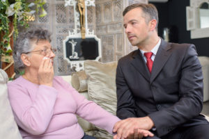 Woman Consoled By Funeral Director
